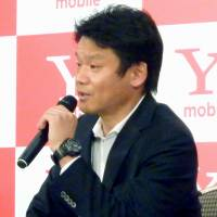 Yahoo Japan Corp. President Manabu Miyasaka addresses a news conference in March to announce Yahoo's foray into the telecommunications business after it acquires a major stake in eAccess Ltd. | KYODO
