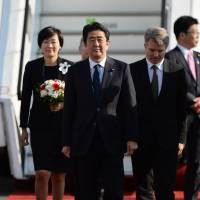 Prime Minister Shinzo Abe and his wife, Akie, inspect a guard of honor after arriving at Berlin's Tegel Airport on April 29. | AFP-JIJI
