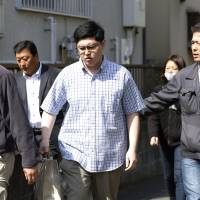 Yoshitomo Imura is taken into custody Thursday in Kawasaki on suspicion of illegal possession of guns made with a 3-D printer.  | KYODO