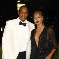 Rapper Jay-Z and his wife, Beyonce Knowles, arrive at the Metropolitan Museum of Art Costume Institute Gala Benefit celebrating the opening of 'Charles James: Beyond Fashion' in Upper Manhattan, New York on May 5. | REUTERS