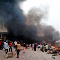 Twin car bombs rip through Nigerian bus terminal, market, killing 118