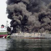 Black smoke billows from the Shoko Maru after the tanker suffered an explosion off Himeji, Hyogo Prefecture, on Thursday morning. | JAPAN COAST GUARD / KYODO