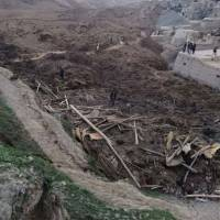 Following a massive landslide which partially buried a village in Afghanistan's Badakhshan province on Friday, locals are seen searching for survivors. | AP