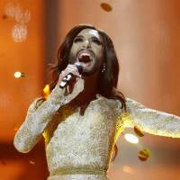 Singer Conchita Wurst, representing Austria, performs 'Rise Like a Phoenix' at the Eurovision Song Contest in Copenhagen on Saturday. | AP