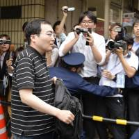 Yusuke Katayama leaves his lawyer's office in Tokyo's Akasaka district Tuesday. He has formally denied sending threatening emails from hacked computers. | KYODO
