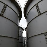 Flange-type storage tanks hold radioactive water at the Fukushima No. 1 power plant complex in November 2013. Radiation from the plant continues to taint nearby seawater, setting new records. | BLOOMBERG