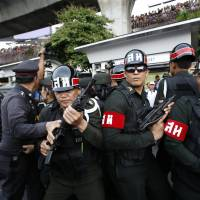 Thai junta muting critics with bond of silence