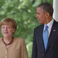 Obama, Merkel vow broader Russian sanctions if Ukraine election derailed