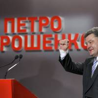 Petro Poroshenko accepts an apparently strong mandate Sunday at his election headquarters in Kiev. Russia's president made no immediate comment, but Vladimir Putin earlier said he would 'respect' the choice of voters. | REUTERS