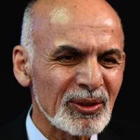 Heading to runoff, Afghan presidential candidates differ in style but not substance
