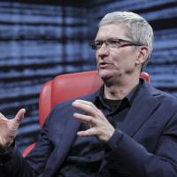 Apple CEO Tim Cook speaks at the Recode Conference in Rancho Palos Verdes, California, on Wednesday. | REUTERS