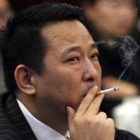 Businessman linked to China's ex-security czar is sentenced to death