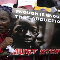 A woman holds a sign Monday during a protest in Lagos demanding the release of abducted secondary school girls from the remote Nigerian village of Chibok. | REUTERS