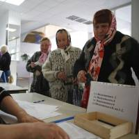 Women visit a polling station to take part in a referendum on the status of the Donetsk region in the eastern Ukrainian city of Slovyansk on Sunday. | REUTERS