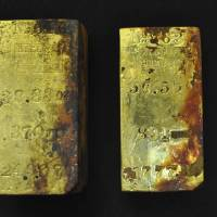 Gold bars are shown in this photo provided by Odyssey Marine Explorations on Monday. The coins were salvaged during Odyssey's first reconnaissance dive to the SS Central America shipwreck site off the coast of South Carolina. | REUTERS