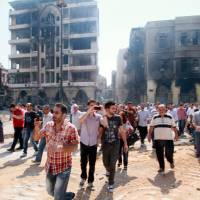 Last Syria rebels leave Homs; residents return to devastated city
