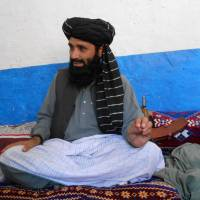 Azam Tariq, a leader of Tehreek-e-Taliban Pakistan, talks with reporters in North Waziristan on Tuesday. His faction of the Pakistani Taliban has announced it is splitting from the militant outfit following bloody clashes with a rival group since March. | AFP-JIJI
