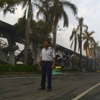 A security guard stands near a damaged Chinese-owned shoe factory in Vietnam's southern Binh Duong province on Wednesday, after thousands of Vietnamese set fire to and looted Chinese and Taiwanese factories in a vicious backlash to the deployment of a Chinese oil rig in contested waters of the South China Sea. | REUTERS