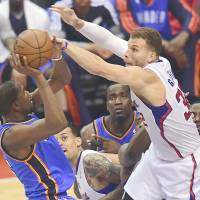 Let's move on: Clippers forward Blake Griffin (right) is hopeful the Donald Sterling situation is resolved during the NBA offseason. | AFP-JIJI
