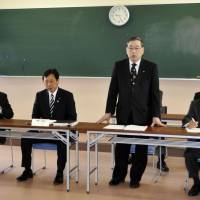 Okuma Mayor Toshitsuna Watanabe (standing) speaks to local assemblymen Thursday in Aizuwakamatsu, Fukushima Prefecture, about the central government's plan to build 'temporary' storage facilities for soil tainted by the March 2011 nuclear disaster. | KYODO