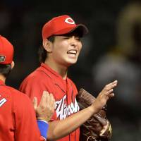 Carp rookie Osera goes distance in win over Tigers