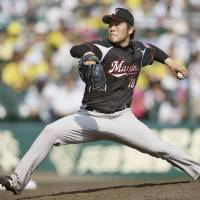 Unconquered: Marines starter Takahiro Fujioka pitches against the Tigers on Sunday at Koshien Stadium. | KYODO