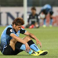 Crushing blow: Frontale's Yoshito Okubo sits on the pitch after Kawasaki's loss to FC Seoul on Wednesday night. | KYODO