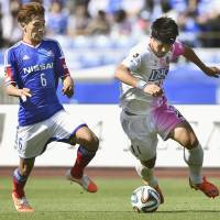 Top dogs: Sagan Tosu striker Yohei Toyoda (right) dribbles the ball during his side's 2-1 win over Yokohama F. Marinos on Saturday. | KYODO