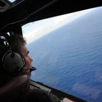 Seekers of Flight 370 rule out area where 'pings' heard