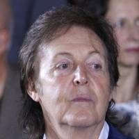 Paul McCartney watches Stella McCartney's ready-to-wear Spring/Summer 2014 fashion collection in Paris on Sept. 30, 2013. McCartney canceled his second concert in Japan on Sunday, as well as the makeup performance for one nixed a day earlier, and apologized to his fans for being sick. | AP
