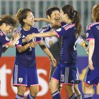 Wonderful feeling: Nadeshiko Japan players celebrate an extra-time 2-1 victory over China in the Women's Asian Cup on Thursday in Ho Chi Minh City. | KYODO