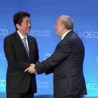 OECD warns Japan's economy may suffer inflation without wage growth
