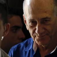Israeli court sentences ex-PM Olmert to six years