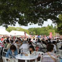 Visitors enjoy local eateries' fare at the food court in Yamashita Park at last year's Yokohama Central Town Festival