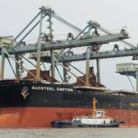 The iron ore carrier Baosteel Emotion, owned by Mitsui O.S.K. Lines Ltd., is moored at a port in China's Zhejiang province last month. | KYODO