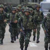Thai army takes power in coup after talks between rivals fail