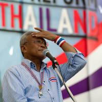 Anti-government protest leader Suthep Thaugsuban delivers a speech during a rally at Government House in Bangkok on Sunday. | AFP-JIJI