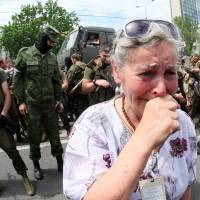 A woman cries as pro-Russia militants hold a parade to mark the Donetsk and Lugansk regions' independence from Ukraine in Donetsk on Sunday. | AFP-JIJI