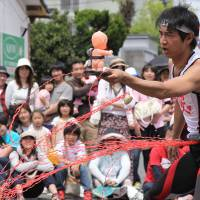 Street style: A performer entertains the audience at last year's Hitachi Kokusai Daidougei.