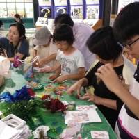 Crafting eco-friendly ideas: Kids and parents take part in a crafting session at Mirai Hotaru Day 2013.