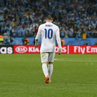 Disappointing defeat: England's Wayne Rooney walks off the pitch after their Group D match against Uruguay on Thursday.  | REUTERS