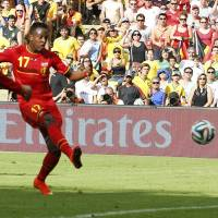 Teenager Origi's late winner puts Belgium into last 16