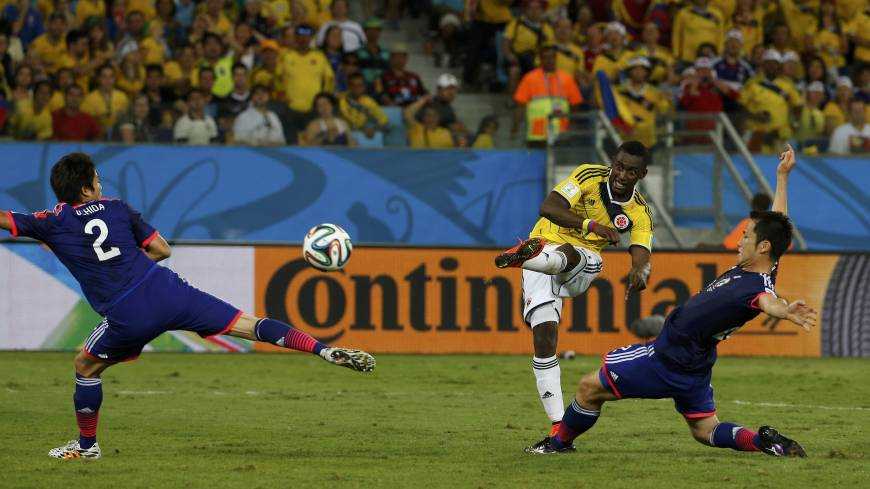 Colombia's Jackson Martinez scores his second goal against Japan during Tuesday's Group C match at the Pantanal arena in Cuiaba.