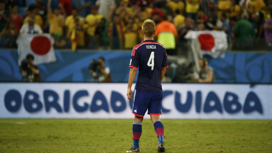 Japan's Keisuke Honda reacts at the end of Tuesday's Group C match against Colombia at the Pantanal arena in Cuiaba.