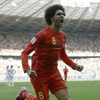 Belgium's Marouane Fellaini celebrates after heading home the equalizer during Tuesday's Group H match against Algeria at Mineirao Stadium in Belo Horizonte. | AP