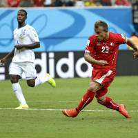 Switzerland's Xherdan Shaqiri scores in the 31st minute of Wednesday's Group E match against Honduras at the Arena da Amazonia in Manaus. | AP