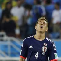 Japan midfielder Keisuke Honda walks off the pitch following their 0-0 draw with Greece on Thursday.
