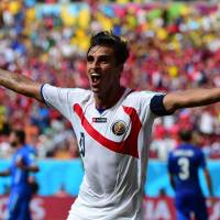 Costa Rica forward Bryan Ruiz celebrates after scoring a goal against Italy on Friday. | AFP-JIJI