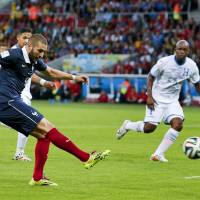Karim Benzema scores his second goal of the match to help lead France to a 3-0 victory over Honduras on Sunday. | AP