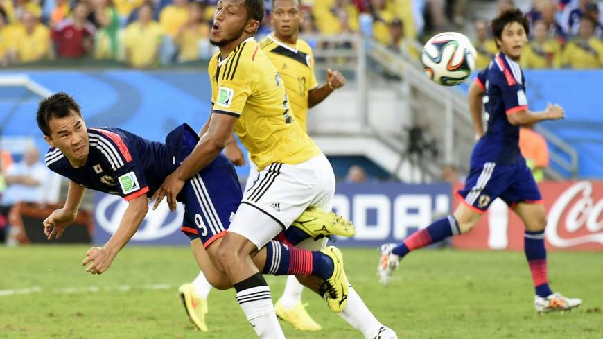 Japan's Shinji Okazaki scores an injury-time equalizer during Tuesday's Group C match against Colombia in Cuiaba.
